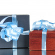 Stock Photo: Gift box with blue ribbon isolated on white background