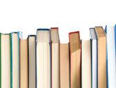 Kupie książki na białym tle — Zdjęcie stockowe