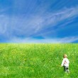 A child walking to the sunlight — Stock Photo #23692779