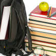 Stock Photo: Welcome to school.Backpack and book heap isolated on white background. Concept