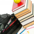 Backpack and book heap - Stock Photo