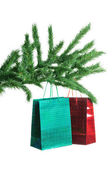 Pine branch and gift bags isolated on white background — Stock Photo