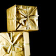 Golden gift boxes isolated on black background — Foto de Stock