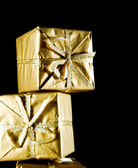 Golden gift boxes isolated on black background — Stock Photo