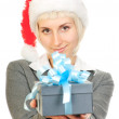 Woman in santa's hat holding gift box — Stock Photo