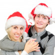 Happy couple in santa's hats isolated on white background — Stock Photo #23810559