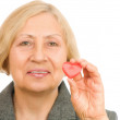 Senior woman holding red Heart  — Stock Photo