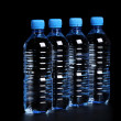 Stock Photo: Bottled water isolated over a black background