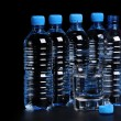 Bottled water isolated over a black background — Stock Photo