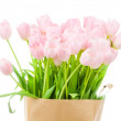 Tulips in paper bag against white background — Stock Photo #25007099