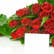 Bunch of red roses an greeting card isolated on white background — Stock Photo #25009963