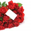 Bunch of red roses an greeting card isolated on white background — Stock Photo #25010373