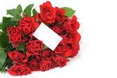Bouquet de roses rouges, une carte de voeux isolée sur fond blanc — Photo