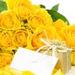 Yellow roses with greeting card — Stock Photo
