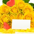 Yellow roses with red hearts and greeting card - Foto Stock