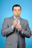 Businessman with flower — Stock Photo
