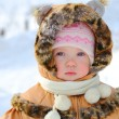 Happy little girl playing in snow — Foto Stock