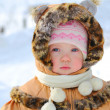 Happy little girl playing in snow — Stock Photo