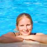 Beautiful woman in outdoor swimming pool — Stock Photo #25550515
