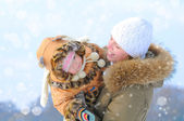 Mother and daughter in winter outdoor — Stock Photo