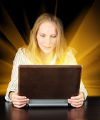 Woman holding magic laptop in her hands — Stock Photo