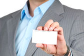 Businessman holding blank card — Foto Stock