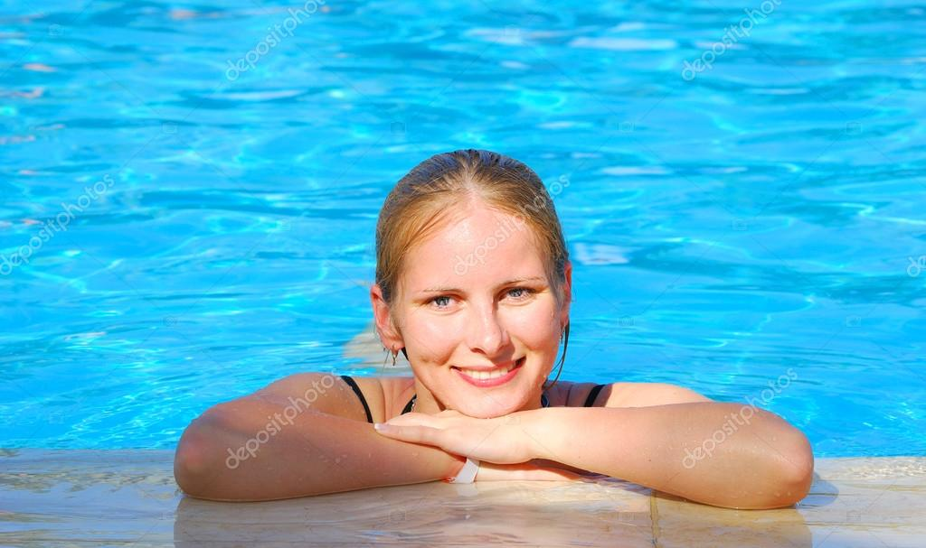 Beautiful woman in outdoor swimming pool stock photo vitaly r 25550515 for Female only swimming pool london