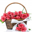 Pink roses in the basket — Stock Photo