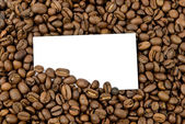 Coffee beans with blank bussines card — Stock Photo