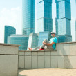 Man relaxing near skyscrapers — Stock Photo #26372079