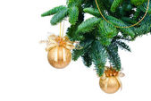 Pine branches and Christmas ornaments isolated on white background — Stock Photo