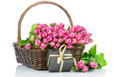 Pink tulips in the wicker isolated on white background — ストック写真