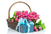 Pink tulips in the wicker with a gift box — Stock Photo