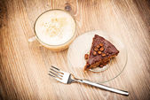 Cup of coffee latte with chocolate cake — Stock Photo