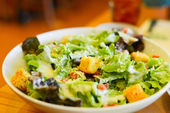 Plate with fresh caesar salad — Stock Photo