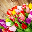 Stock Photo: Tulips on wooden background