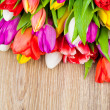 Tulips on wooden background — Stock Photo #40901945