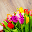 Tulips on wooden background — Stock Photo