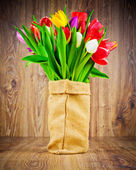 Tulips flowers in the sack — Stock Photo