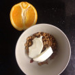 Breakfast with muesli and orange — Stock Photo