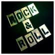 Rock and roll stencil. Graffiti, spray paint vintage retro letters. Graphics font. — Stock Photo #26896245