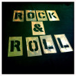 Rock and roll stencil. Graffiti, spray paint vintage retro letters. Graphics font. — Stock Photo