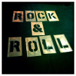 Rock and roll stencil. Graffiti, spray paint vintage retro letters. Graphics font. — Stock Photo #26896255