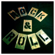 Rock and roll stencil. Graffiti, spray paint vintage retro letters. Graphics font. — Stock Photo #26896273