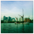 London - Thames sailing barge sails down river past Canary Wharf. Old world meets New world. — Stock Photo