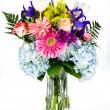 Bouquet of colorful flowers in a glass vase. — Stock Photo