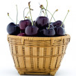 Sweet black cherries in a wood basket — Stock Photo #22808764