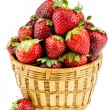 Ripe strawberries in a wicker basket isolated on a white backgro — Stock Photo #25819781