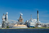 Industrial Paper Mill on a River — Stock Photo