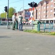 Cologne - circa april 2013 - Tram ( Line 7 ) runs through a crossing with barriers on the railway line between Cologne and Zündorf — Stock Video
